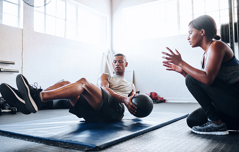 trainer helping client do cardio resistance training