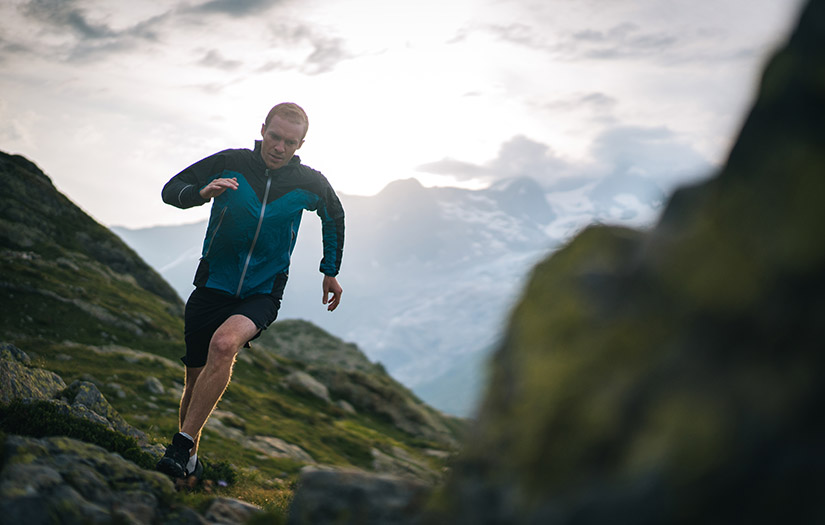 ultra endurance athlete running on a mountain